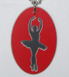 BALLET DANCER TAG  This hardened plastic Ballet Dancer Tag is designed for those who love the beauty of ballet, whether it be to watch it or to dance it. This tag is 26mm x 40mm (slight deviations to this measurements may occur due each tag being individually handcrafted).  It can be made in different colours.  A portion of every sale goes directly to the Friends of Brain Injured Children (FBIC)