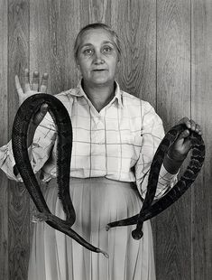 Congregant of an Appalachian serpent handling church holding poisonous snakes. Photo Shelby Lee Adams.