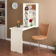 This winter white writing desk folds up onto the wall, neat and compact. Fold the desk down for a convenient storage area.