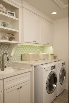 White and organized laundry room. Laundry room design.Design // Austin Bean Design Studio Photography // Jenifer Jordan