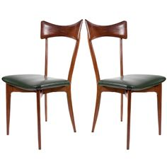 Couple of dining chairs by Ico Parisi for F.lli Colombo  Italy  1950s  Couple of sculptural dining chairs, wood and artificial leather