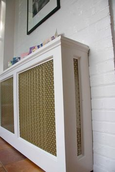 Make Your Own Radiator Covers for Extra Shelf Space...yes yes yes but where to find this nice pierced grill?