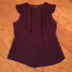Purple ruffle blouse Bebe purple ruffled blouse. Button up the front. Flutter sleeve bebe Tops Blouses