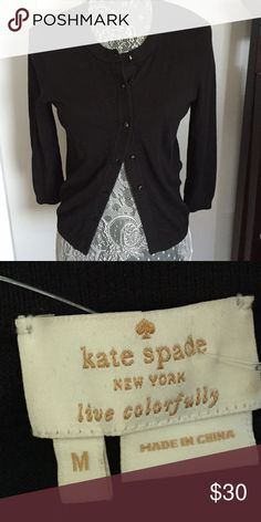 Kate spade cardigan Wardrobe staple alert! Great little black cardigan by Kate spade.  Good preowned condition but does have some slight pilling. Therefore priced accordingly kate spade Sweaters Cardigans
