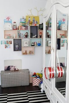 Shadowboxes...could use shoe boxes too and paint or cover in fun fabric colors or prints.  Great idea for decor or storage for playroom.  Playrooms need lots of storage!!