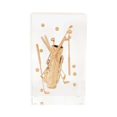 Whimsical lucite and brass sculpture with golfing motif.