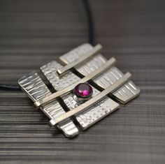 Sterling+silver+and+ruby+gemstone+segmented+by+MarkWhiteDesigns,+$89.50
