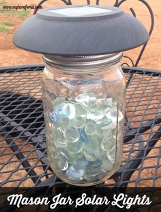 Mason jar lighting using the tops of solar lights and a few gems to reflect the soft lighting. : Mason jar lighting using the tops of solar lights and a few gems to reflect the soft lighting for your patio or yard, Tin Can Lanterns, Garden Lanterns, Solar Lanterns, Solar Chandelier, Mason Jar Solar Lights, Mason Jar Lighting, Jar Lights, Solar Lights For Yard, Pot Mason Diy