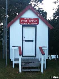 Claimed to be the World's Smallest Post Office at 8 feet 4 inches wide x 12 feet inches deep. Boxes for 94 people. Office Mailboxes, Outer Banks Nc, Mail Call, World's Smallest, You've Got Mail, Mailbox Post, Going Postal, Hatteras Island, North Carolina Homes
