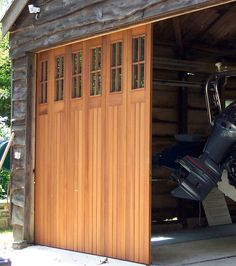 We offer horizontal folding wooden commercial sliding garage doors. Our sliding garage doors are an effortless and easy to use operation. Garage Door Track, Unique Garage Doors, Roll Up Garage Door, Sliding Garage Doors, Home Gym Garage, Sliding Door Design, Garage Door Design, Shed Doors, House Doors