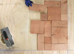 unique flooring Learn how to create beautiful, unique floors out of reclaimed materials with this simple guide to end-grain flooring. Modern Flooring, Unique Flooring, Brick Flooring, Diy Flooring, Ceramic Flooring, Inexpensive Flooring, Terrazzo Flooring, Basement Flooring, Flooring Options