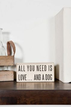 """""""All you need is love ...and a dog"""" This humorous (and often true) saying is printed ona distressed wooden box sign. On the wall or on the shelf, this cute little sign will be a perfect gift for any dog lover!<br /> <br /> - 4.75"""" x 2.25""""<br /> - By Primitives by Kathy<br /> - Imported<br />"""