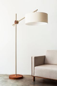 "This Floor Lamp in Painted Steel and Pau Ferro Hardwood is in the minimalist style. For the 'Rotula"" floor lamp fixture, Alessandra Delgado was inspired by the subtle elegance of the human body. The designer chose hues of cooper, gold, brown and Home Lighting, Room Lamp, Living Room Flooring, Flooring, Lamps Living Room, Modern Floor Lamps, Fashion Room, Floor Lamp Design, Modern Lamp"