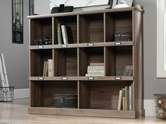 "Cubbyhole storage for books, binders, framed photos, collectibles, and more. Accommodates ID label tags. Top shelf with gallery display. Salt Oak finish.Overall Dimensions: 53 1/8"" W x 12 1/8"" D x 47 1/2"" H"