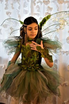 Exquisite deluxe WoodLand fairy tutu dress. Satin/silk foliage for the front that and goes up to sleeves. Each strip of tulle is carefully cut and shaped into this distressed luxury Fairy dress costume. Shoulders have distressed tulle sleeves colors are : hunter green olive green green brown black beige Fairy gloves, necklace and ankle bracelets are avialable in my other listings or by requesting a custom order. Fairy wings sold separately Custom colors are available in any combination...
