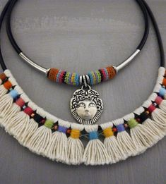 This is a handmade colorful tribal statement necklace in aboriginal indian style made out of black genuine leather round cord, natural off white unbleached cotton yarn, color threads, seed beads, s…