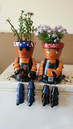 My flowers pot heads. Meet Daisy and Susie Q. Made these for my Aunt' birthday.  These are the first set I made. Not my original idea but my original artwork.  Down to my own Harley Davison logo.
