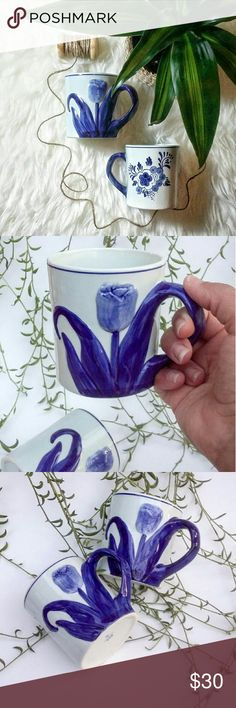 """Delfts Blauw Tulip Mugs (set of 2) Vintage Delfts Blauw Tulip Mugs  These are beautifully hand painted - featuring a 3-D Tulip near the handle and floral scene on the other end  Lovely curvature on the handle to resemble an extension of the flower  Made in Holland,hand painted, Lot 533   Size;  3.5"""" T?  4"""" W (including handle)  Condition::  Vintage condition - Slight wear  Note:  Due to the nature of """"pre-loved"""" vintage items, please do not expect them to arrive """"new"""" Accessories"""