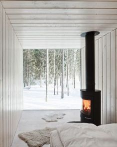 """42 Lovely Scandinavian Fireplace To Rock This Year. A stone fireplace design your pioneer ancestors would envy is the """"Multifunctional Fireplace. Home Interior, Decor Interior Design, Interior Design Living Room, Interior Decorating, Decorating Tips, Scandinavian Fireplace, Scandinavian Home, Design Room, White Down Comforter"""