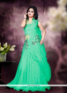 We unfurl our the intricacy and exclusivity of our creations highlighted in such a gorgeous sea green net designer gown. The cutdana and resham work on dress personifies the overall appearance. (Sligh...