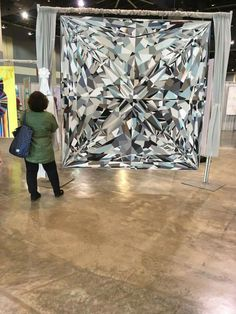 What an incredible quilt. To be able to translate the facets and glimmer of a diamond to fabric is a rare visual talent.