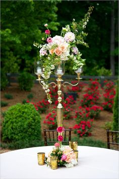candelabra centerpiece with florals #weddingreception #weddingflorals #weddingchicks http://www.weddingchicks.com/2014/02/27/sophisticated-stable-wedding/