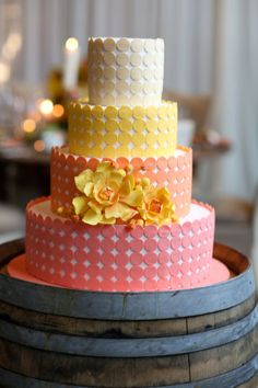 modern dot cake with a pink & yellow color palette.