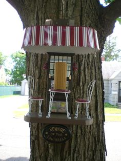 This is a squirrel feeder our son, Mike , made for us. Looks like a littel cafe and has tons of details that don`t show up in this photo....so come by and take a look at it. It even lights up at night. The squirrels are going to love it!- Linda