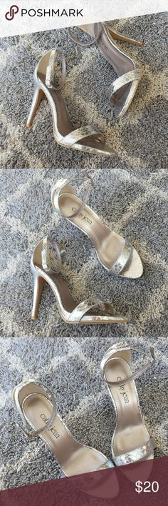 """NWOT Cathy Jean silver snake heels New without tags/box Cathy Jean silver metallic snake print heeled sandals. Minimalist type with thin strap across foot and thin ankle strap with adjustable buckle. Highly reflective embossed snakeskin print. Size 9. In new condition with no flaws. Heel measures 4.5"""". Cathy Jean Shoes Heels"""
