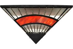 As described by Mediterranee Antiques   Art Deco-style iron fan-shaped sconce with red slag glass. Wired for US use and in working condition.