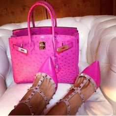 talk about making a statement! valentino rock stud heels in shocking pink with a matching ostrich hermes birkin .... geez, must be nice!