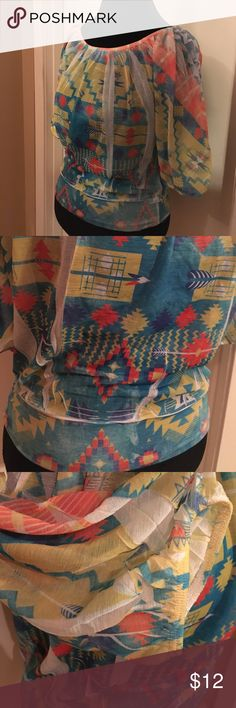 Rue 21 tribal print top M 100% polyester,fitted waistband,elastic at sleeve end,colors of turquoise,yellow,orange and white,size medium,like new Rue 21 Tops