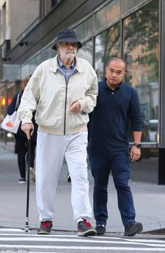 Keeping active: Sean Connery was sported on a walk with his caregiver on Monday morning in Manhattan
