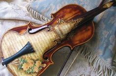 This is beautiful but my dad would cringe  at the use of a musical instrument for an art project-no matter how gorgeous.