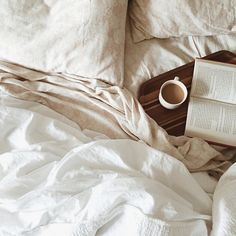 Morning sunlight, a cozy bed, a great book and hot coffee. Some of life's little treasures.