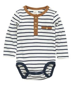 Check this out! Long-sleeved bodysuit in ribbed cotton jersey with a button placket, decorative chest pocket, and snap fasteners at gusset. - Visit hm.com to see more.