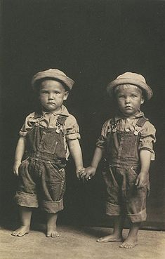 Mike Disfarmer, Leo and Leon Todd  ca. 1930, Vintage gelatin silver, printed ca. 1930  boys hold hands farmers kids rural life overalls little kids