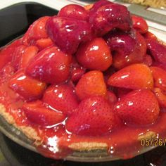 This is a simple yet wonderful pie!  The strawberries are piled high.... and aren't mushy... but fresh!   This is not an overly sweet pie... the flavor of the fresh strawberries shine through... It can be made with regular or sugar free Jell-O.  If you like strawberries... this is the pie for you!  It looks like you worked on it all day...  When you bring this pie out for dessert... everyone's eyes get so big... and so do the smiles! .