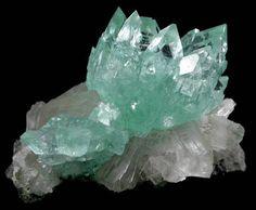 Apophyllite (rare blue-green color) on Heulandite. #crystal #mineral