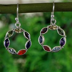 These Chakra earrings are perfectly handcrafted with 7 gemstones - amethyst, blue lace, citrine, carnelian, emerald, garnet, and lapis. the 7 gemstones correspond to 7 chakras in the body. <br /><br /> [$65.00]
