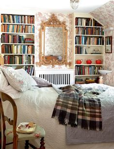 I want an extra bedroom in our forever home as a reading retreat....with the world's comfy-ist bed and a wall full of books, and a beautiful chandellier :)