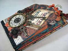 Annette uses our Regular Tag Album Staples to create this magnificent Steampunk Spells mini album! Click to see more photos of this great project #graphic45 #minialbums #tags