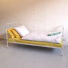 Child's bed made of wrought iron. Painted white.