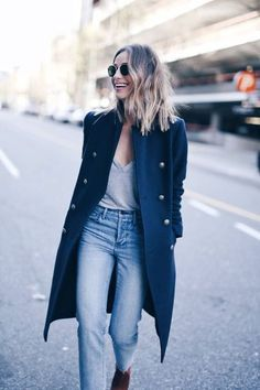 {Coat and high-waisted denim.}