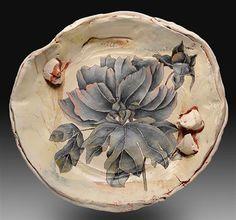 Tim Ludwig: http://carterpottery.blogspot.com/2010/09/tim-ludwigs-beautiful-pots.html