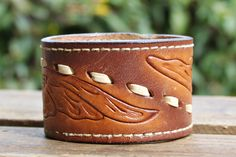 CUSTOM HANDSTAMPED brown leather cuff with stitching detail by mothercuffer on Etsy