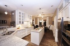 White Shaker Style Cabinets with Granite Countertops - Dakine Home Builders