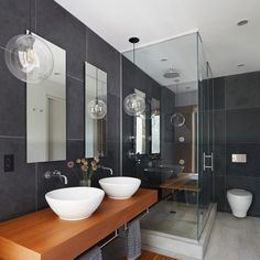 In this #Brooklyn #townhouse designed by #EtelakamiArchitecture, each of the three #bathrooms is different than the next. There's even one with our Crystal Solitaire #pendant #lights.