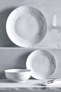All marble EVERYTHING! This dining set is DIVINE! Subtle touches will keep your kitchen on trend.