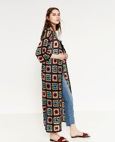 A granny dress-inspired crochet patchwork coat from Zara's current spring/summer collection.